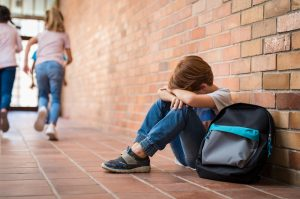 Photo of crying boy in school hallway | Child Separation Anxiety | Child Therapist & Child Counseling | Atlanta, GA area | Roswell, GA 30076