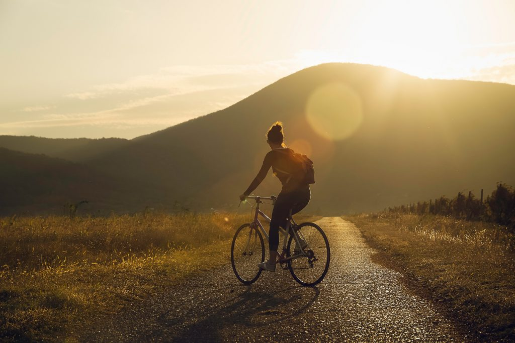 Photo of a woman riding a bicycle | Trauma Therapist | Psychotherapy | Wellview Counseling | Atlanta area | Roswell, GA 30076