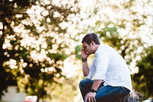 Photo of sitting man looking overwhelmed | Trauma & PTSD Treatment | Trauma Counseling near Atlanta, GA | Wellview Counseling | Roswell, GA 30076