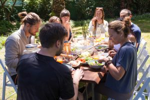 Photo of family sitting at a table outside while eating a meal | family therapist in Atlanta, GA | Wellview Counseling | 30076
