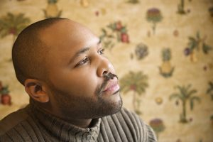 Black man finding healing from trauma in trauma therapy | counseling and therapy with trauma therapists in Atlanta 30076