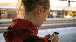 young girl looks at negative body image photo on her cell phone before going to teen counseling with a teen therapist in the Atlanta, GA area at Wellview Counseling 30076