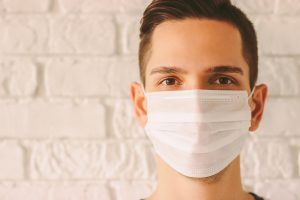 confident man in a mask after online therapy in Georgia for coronavirus anxiety with Wellview counseling