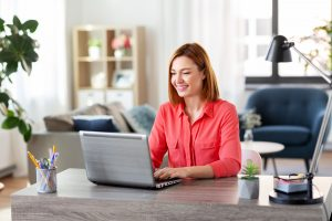 woman smiles during online therapy in Georgia with Wellview Counseling 30076