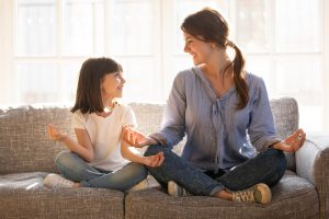 peaceful woman meditating with her daughter after they got child counseling in Roswell, GA.