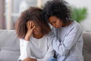 Mom strugging to comfort her young daughter. She needs tips for talking to her kid about child counseling in Roswell, GA. Child therapist Ashley Bobo from Wellview Counseling offers tips